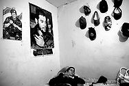Maximo, 34, rests in his room adorned with side-by-side posters of Che Guevara and Hugo Chavez in Venezuela on Tuesday, Jan. 8, 2008. Maximo is the only adult male responsible for providing for the sixteen women and children that live in his family home located in the red zone of Belen.  He proudly identifies himself as a member of the Bolivarian Revolution, sympathetic to the though of legendary Latin American revolutionary, Che Guevara and present day President of the Bolivarian Republic of Venezuela, Hugo Chavez. Maximo was fatally shot on Thursday, April 24, 2008 in Belen.
