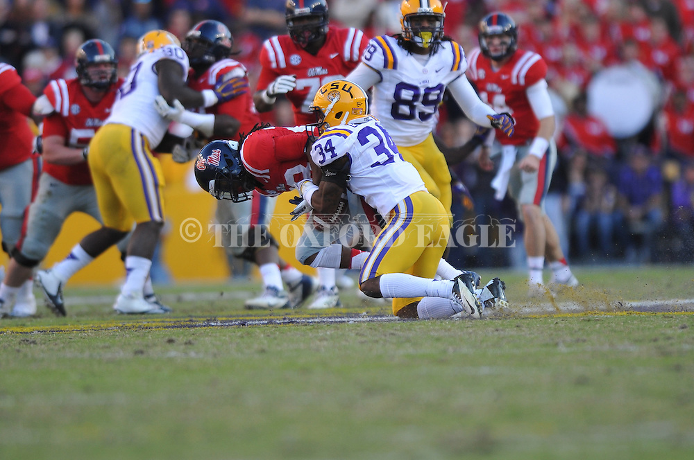 Ole Miss wide receiver Korvic Neat (28) is nable to hold onto a pass as LSU safety Micah Eugene (34) defends at Tiger Stadium in Baton Rouge, La. on Saturday, November 17, 2012.....