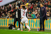 Martina Voss-Tecklenburg, Head Coach of Germany FC  and Phil Neville, Head Coach of England FC as Lucy Bronze (England) throws in a ball during the International Friendly match between England Women and Germany Women at Wembley Stadium, London, England on 9 November 2019.
