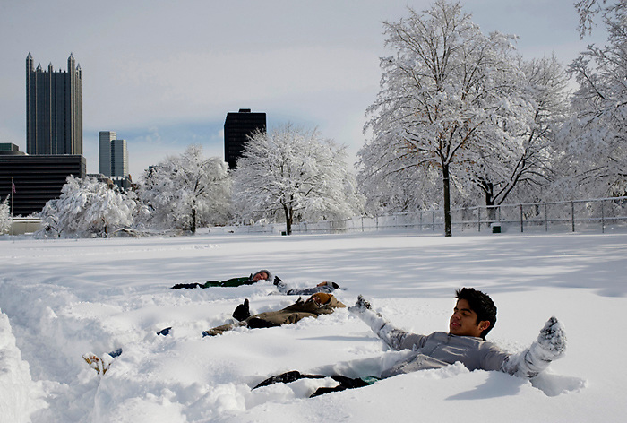 Point Park University freshman Jossue Delgado ( right, front) attempts to make a snow angel in nearly two-feet of snow at Point State Park.  The severe storm that hit Pittsburgh in early February was the fourth worst recorded snowstorm in the region's history.