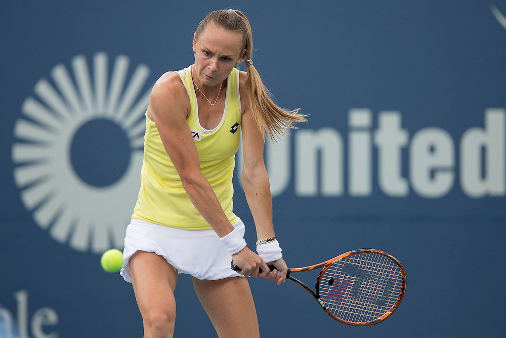 August 23, 2014, New Haven, CT:<br /> Magdalena Rybarikova hits a backhand during the singles final against Petra Kvitova on day nine of the 2014 Connecticut Open at the Yale University Tennis Center in New Haven, Connecticut Saturday, August 23, 2014.<br /> (Photo by Billie Weiss/Connecticut Open)