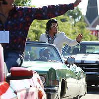 Bill Cherry, Elvis Tribute Artist, waves to fans during the Elvis Homecoming Parade Thursday in Tupelo.