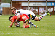 Bradford Bulls centre Lee Smith (1) tackles Sheffield Eagles scrum half Remy Marginet (27)  during the Kingstone Press Championship match between Sheffield Eagles and Bradford Bulls at, The Beaumont Legal Stadium, Wakefield, United Kingdom on 3 September 2017. Photo by Simon Davies.