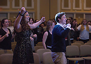 Abby Fajack, left, and Ty Tracy, right, members of Alpha Phi Omega and the emcees of the Faculty Pageant, dance at the pageant on February 22, 2016. Alpha Phi Omega hosted the event to raise money for Camp Quality, a camp for children with cancer and their siblings.