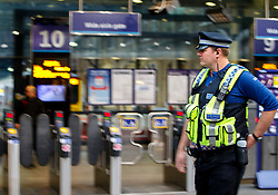 © Licensed to London News Pictures. 07/12/2015. London, UK. Police officers patrolling at King's Cross station in London on Monday, 7 December 2015. Photo credit: Tolga Akmen/LNP