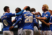 Craig Westcarr celebrates with the majority of the Portsmouth squad after scoring during the Sky Bet League 2 match between Portsmouth and Morecambe at Fratton Park, Portsmouth, England on 22 November 2014.