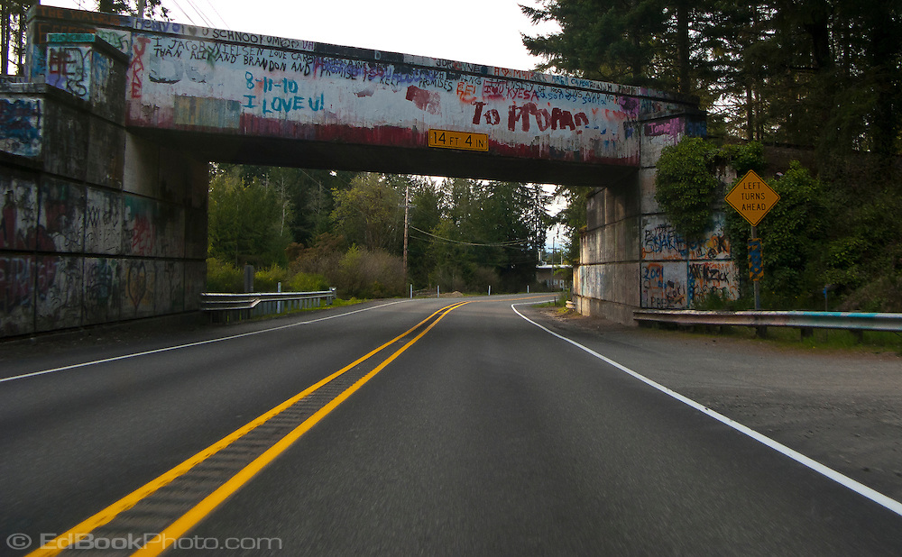 scene along a cross country trip with in a classic Mini Cooper auto - graffiti painted on a railroad overpass painted on a railroad overpass along WA SR-3