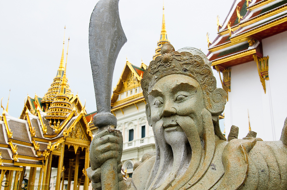 Traditional statue at the temple Wat Phra Kaeo in the Grand palace area in Bangkok, Thailand