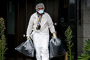 Tokushige Kowata leaves his home with for what he believes will be the last time after he and other residents were allowed briefly to return and collect valuables and other belongings from their homes inside the nuclear exclusion zone in Okuma, Fukushima Prefecture, Japan on Aug. 31 2011. Robert Gilhooly Photo