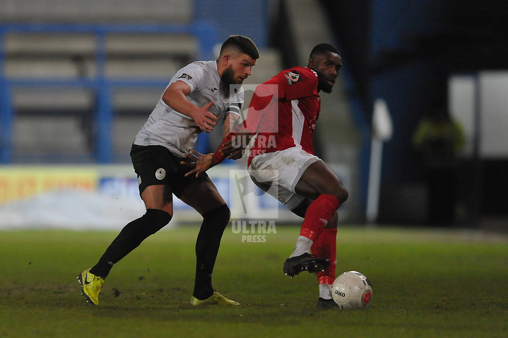 TELFORD COPYRIGHT MIKE SHERIDAN Shane Sutton of Telford battles for the ball with Lee Ndlovu of Brackley during the Vanarama Conference North fixture between AFC Telford United and Brackley Town at the New Bucks Head on Saturday, January 4, 2020.<br /> <br /> Picture credit: Mike Sheridan/Ultrapress<br /> <br /> MS201920-039