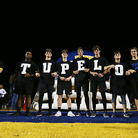 The Tupelo Boys line up before leading the football team out onto the field Friday night before the start of the final regular season game of the year.