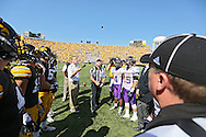 September 15 2012: The players and officials watch the coin toss before the start of the NCAA football game between the Northern Iowa Panthers and the Iowa Hawkeyes at Kinnick Stadium in Iowa City, Iowa on Saturday September 15, 2012. Iowa defeated Northern Iowa 27-16.