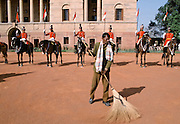 Sweeping up in front of ceremonial guard at Rashtrapati Bhavan presidential house, formerly Viceroy's House, in New Delhi, India