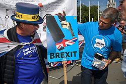 © Licensed to London News Pictures. 15/05/2019. London, UK. Remain campaigner STEVE BRAY (left) is seen remonstrating with a Brexit Party supporter in Westminster, London. Government has announced that MPs will get another chance to vote on Theresa May's Brexit Bill in early June, after EU parliament elections. Photo credit: Ben Cawthra/LNP