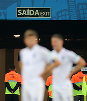 A dejected looking Steven Gerrard and Gary Cahill of England stand under an exit sign after Luis Suarez of Uruguay scores a goal to make it 2-1