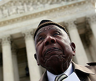 Harvard Law Professor Charles Ogletree, not pictured, filed an appeal on the Tulsa federal court ruling that they are not entitled to reparations fro the 1921 Tulsa race riot at the Supreme Court of the United States on Wednesday, March 9. With Ogletree were five survivors of the riots including Otis Clark, pictured, 102 who ceremoniously carried a copy of the brief up the court''s steps accompanied by the lawyers Ogletree and Michael Hansfeld.
