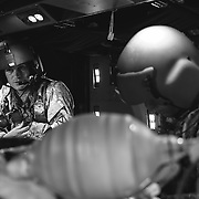 Performing critical care in the limited space of a HH-60M simulator cabin.