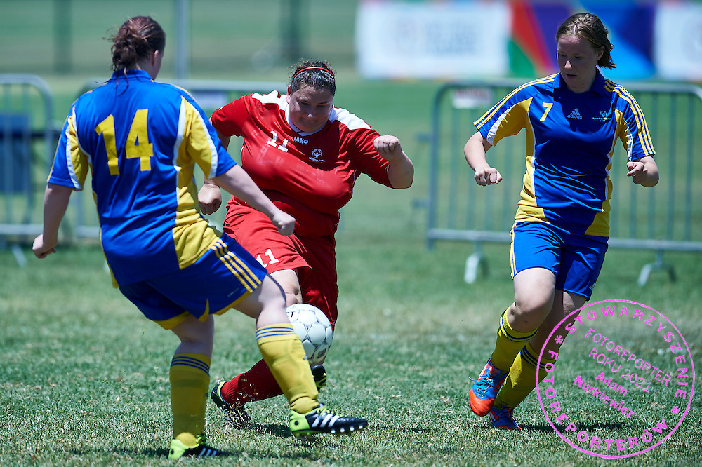SO Poland athlete (C) fights for the ball with SO Sweden athlete (R) while football women match 7-a-side during fourth day of the Special Olympics World Games Los Angeles 2015 on July 28, 2015 at Balboa Sports Centre in Los Angeles, USA.<br /> USA, Los Angeles, July 28, 2015<br /> <br /> Picture also available in RAW (NEF) or TIFF format on special request.<br /> <br /> For editorial use only. Any commercial or promotional use requires permission.<br /> <br /> Adam Nurkiewicz declares that he has no rights to the image of people at the photographs of his authorship.<br /> <br /> Mandatory credit:<br /> Photo by &copy; Adam Nurkiewicz / Mediasport