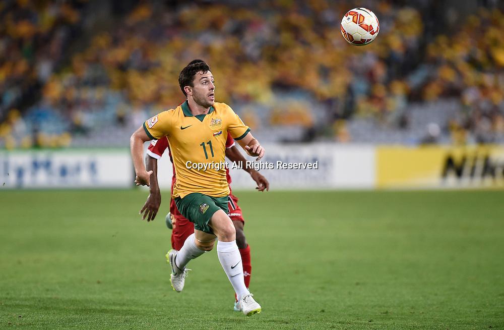13.01.2015.  Sydney, Australia. AFC Asian Cup Group A. Australia versus Oman. Australian midfielder Tommy Oar chases down the high ball. Australia won the game 4-0.