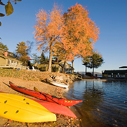 Kayaks on the shore on Lake Winnipesauke at Oliver Lodge in Meredith, New Hampshire.