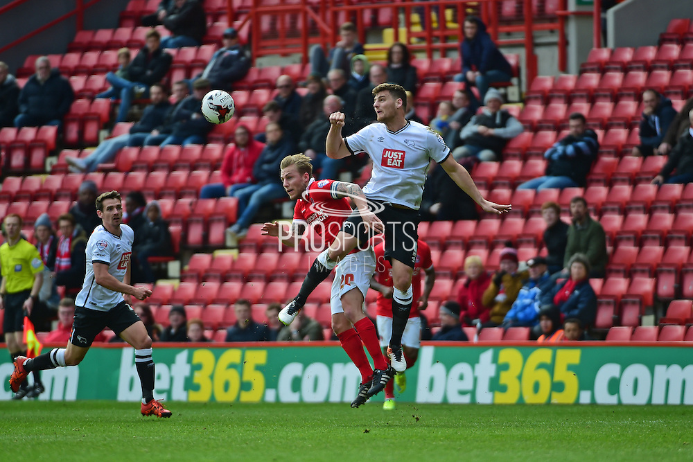Derby County midfielder Chris Martin out jumps Charlton Athletic Chris Solly during the Sky Bet Championship match between Charlton Athletic and Derby County at The Valley, London, England on 16 April 2016. Photo by Jon Bromley.