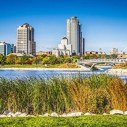 Picture of Milwaukee Skyline and Lakeshore State Park. Picture includes the Lakeshore State Park Inlet, University Club Tower, Northwestern Mutual Tower, and Milwaukee Art Museum. Lakeshore State Park is a Wisconsin State Park with walking trails and public recreational activities. Photo is high resolution.