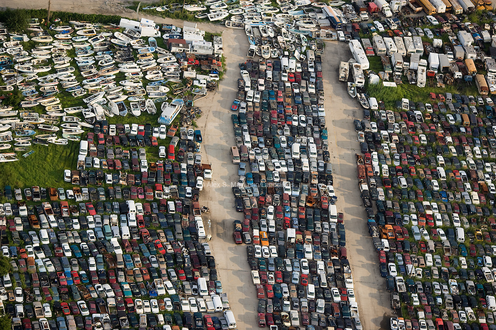 A junkyard overflows with cars, boats, and mobile homes, all damaged by Hurricane Katrina.