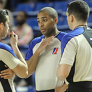 officials VLADIMIR VOYARD-TADAL (48) ISAAC BARNETT and ANDY O' BRIEN (18) conference in the first half of a NBA D-league regular season basketball game between the Delaware 87ers and the Raptors 905 Friday, Jan. 15, 2016. at The Bob Carpenter Sports Convocation Center in Newark, DEL.