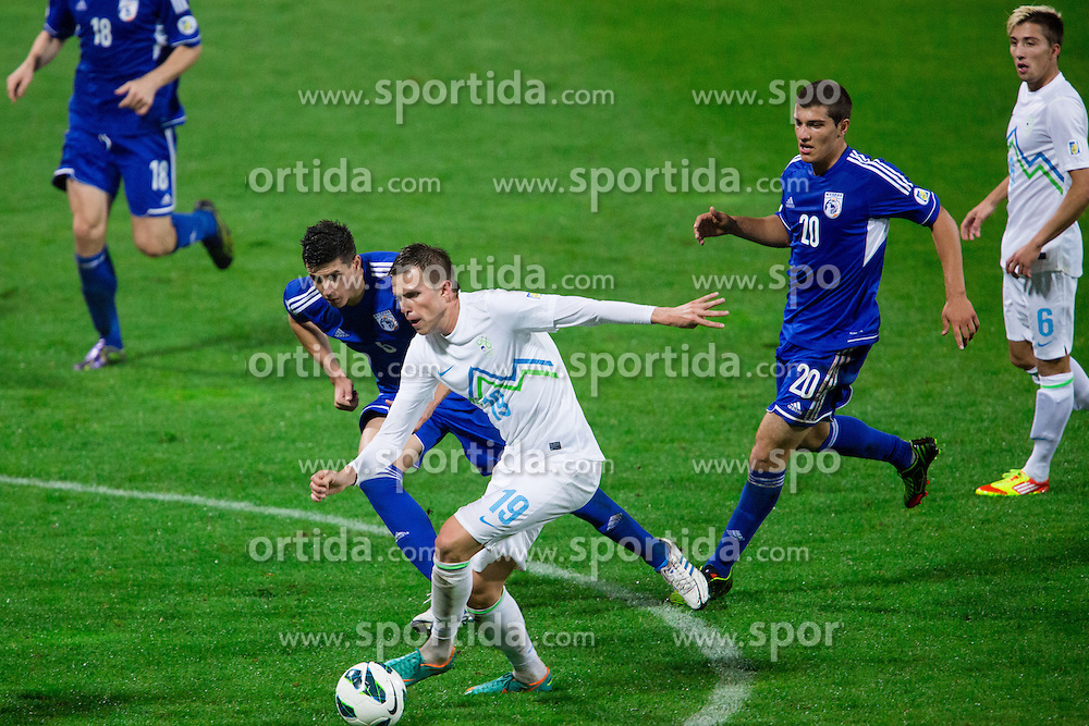 Josip Ilicic of Slovenia vs Angelis Charalampous of Cyprus during football match between National teams of Slovenia and Cyprus in 3rd Round of Group E of FIFA World Cup 2014 Qualification on October 12, 2012 in Stadium Ljudski vrt, Maribor, Slovenia. (Photo by Matic Klansek Velej / Sportida)