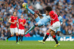 Fernando of Manchester City kicks the ball in the compete in the air as Marouane Fellaini of Manchester United challenges - Photo mandatory by-line: Rogan Thomson/JMP - 07966 386802 - 02/11/2014 - SPORT - FOOTBALL - Manchester, England - Etihad Stadium - Manchester City v Manchester United - Barclays Premier League.