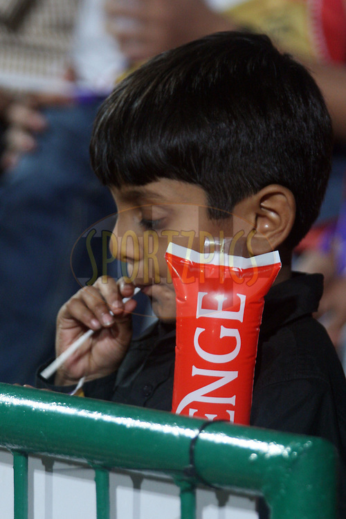 An young boy seems to enjoy his own game during match 8 of the the Indian Premier League ( IPL ) Season 4 between the Royal Challengers Bangalore and the Mumbai Indians held at the Chinnaswamy Stadium, Bangalore, Karnataka, India on the 12th April 2011..Photo by Vino John/BCCI/SPORTZPICS