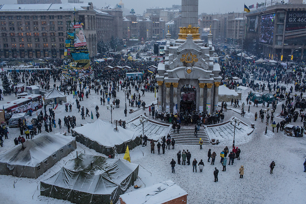 KIEV, UKRAINE - DECEMBER 11: Anti-government protesters congregate on Independence Square, known as the Euromaidan, on December 11, 2013 in Kiev, Ukraine. Thousands of people have been protesting against the government since a decision by Ukrainian president Viktor Yanukovych to suspend a trade and partnership agreement with the European Union in favor of incentives from Russia. (Photo by Brendan Hoffman/Getty Images) *** Local Caption ***