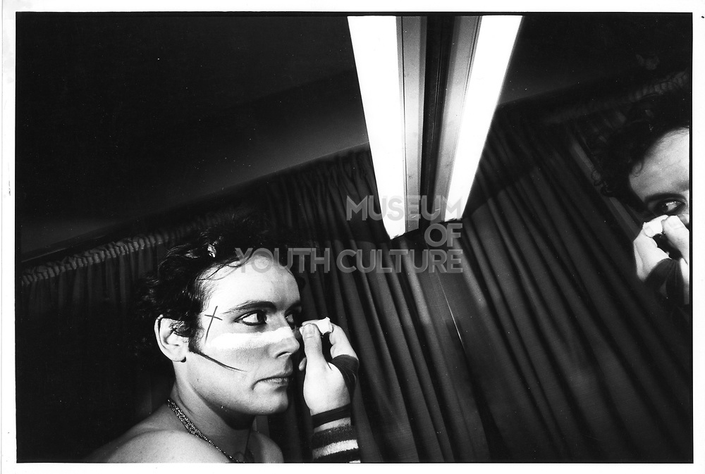Adam Ant applying his stage make up, 1980