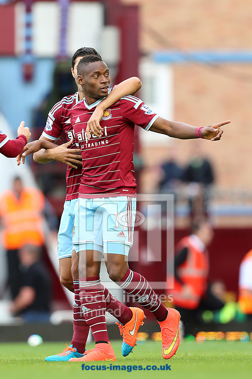 Diafra Sakho celebrates after scoring the opening goal of the Barclays Premier League match against Queens Park Rangers at the Boleyn Ground, London<br /> Picture by Richard Calver/Focus Images Ltd +447792 981244<br /> 05/10/2014