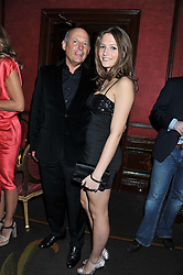 RON DENNIS and his daughter CHARLOTTE DENNIS at the 39th birthday party for Nick Candy in association with Ciroc Vodka held at 5 Cavindish Square, London on 21st Januatu 2012.