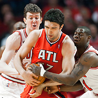 04 May 2011: Chicago Bulls shooting guard Ronnie Brewer (11) vies for the ball with Atlanta Hawks center Zaza Pachulia (27) during the Chicago Bulls 86-73 victory over the Atlanta Hawks, during game 2 of the Eastern Conference semi finals at the United Center, Chicago, Illinois, USA.