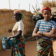 Saadiya Issaka (right, approximately 15) and Mariama Makhoudil (approximately 20) in the village of Kouka Samou in the Zinder region of Niger.