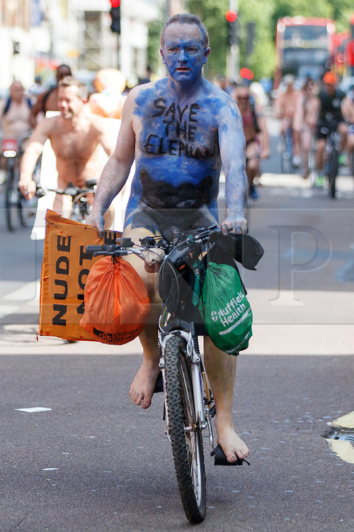 © Licensed to London News Pictures. 10/06/2017. London, UK. Nude protesters take part in a naked bike ride in central London on Saturday, 10 June 2017 as part of the World Naked Bike Ride event, which protests against car culture and aims to raise awareness of cyclists on the roads. Photo credit: Tolga Akmen/LNP