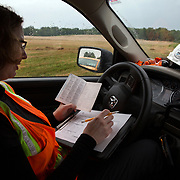STERLING, VA - JUN13: Cythina Hauser, an Endangered Species Biologist and Project Environmental Specialist with GAI Consultants, takes field notes in her truck, July 13, 2015, during a bat census to make sure the planned Silver Line train yard near Dulles Airport doesn't impact the bats living in the woods near the site. Fine 'mist nets' are hung from polls to capture bats and determine whether there is a threatened bat species in the area. The bats are then released. (Photo by Evelyn Hockstein/For The Washington Post)