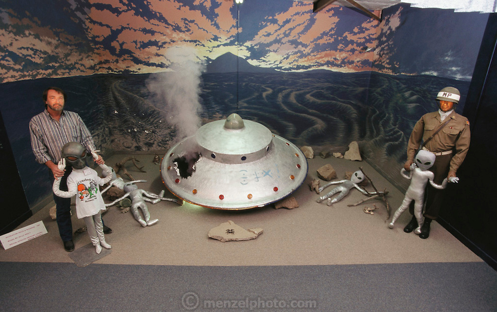 UFO museum exhibit. UFO crash diorama exhibit in the UFO Enigma Museum in Roswell, USA. The town has many tourist attractions around the theme of UFO's. It was near Roswell on the evening of 2 July 1947 that many UFO sightings were reported during a thunderstorm. Next morning a rancher, Mac Brazel, discovered strange wreckage in a field. When the impact site was located, a UFO craft and alien bodies were allegedly found. On 8 July 1947, the Roswell Daily Record announced the capture of a flying saucer. The official explanation was that it was a crashed weather balloon. Many Roswell inhabitants, however, believe this a cover up, and Roswell has become a symbol for UFO enthusiasts. Model Released (1997)