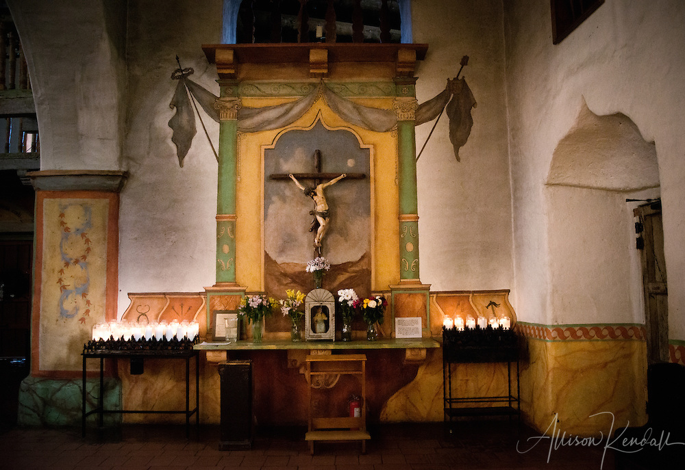 Interior details of the mission at San Juan Bautista, including the cathedral decorated for the Christmas holiday season, and exhibits illustrating historical details of the mission.