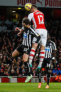 Olivier Giroud of Arsenal (right) scores the opening goal against Newcastle United during the Barclays Premier League match at the Emirates Stadium, London<br /> Picture by David Horn/Focus Images Ltd +44 7545 970036<br /> 13/12/2014