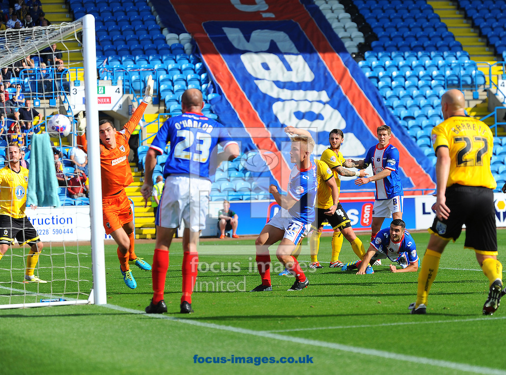 Kyle Dempsey of Carlisle United (centre) scores his team's second goal during the Sky Bet League 2 match at Brunton Park, Carlisle<br /> Picture by Greg Kwasnik/Focus Images Ltd +44 7902 021456<br /> 06/09/2014