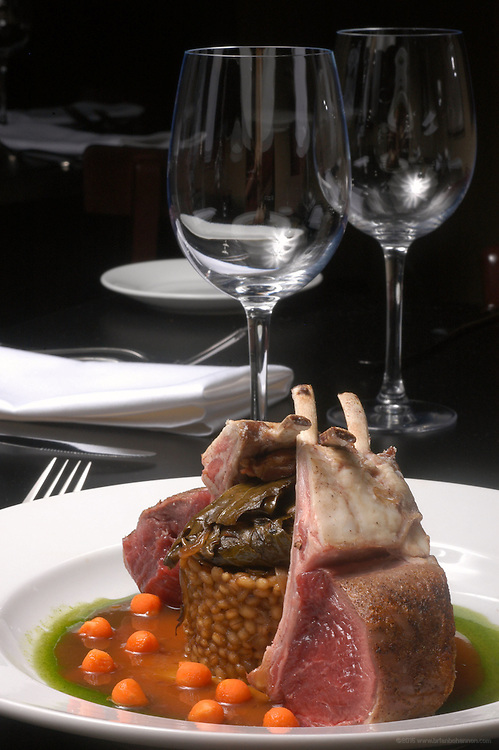 Bourbon's Bistro: Roasted Rack of Lamb, pearled barley and bourbon-braised greens with natural jous and mint syrup.