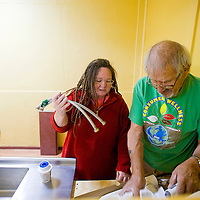 100312       Brian Leddy<br /> Kayt Gutierrez and her husband Marty work on getting a sink installed at The Hozho Center Thursday afternoon. The new community center will offer a range of services for the entire community.