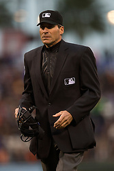 SAN FRANCISCO, CA - MAY 20:  MLB umpire Angel Hernandez #55 stands behind home plate during the first inning between the San Francisco Giants and the Los Angeles Dodgers at AT&T Park on May 20, 2015 in San Francisco, California.  The San Francisco Giants defeated the Los Angeles Dodgers 4-0. (Photo by Jason O. Watson/Getty Images) *** Local Caption *** Angel Hernandez