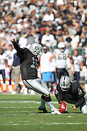 OAKLAND, CA - OCTOBER 10: Sebastian Janikowski #11 of the Oakland Raiders kicks a field goal against the San Diego Chargers at Oakland-Alameda County Coliseum on October 10, 2010 in Oakland, California. (Photo by Tom Hauck) Player:Sebastian Janikowski