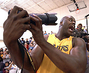 Shaq takes a self portrait of himself with Over 600 children from the El Segundo area behind him.  The kids were invited to the Lakers practice facility to take part in a .Read to Acheive event sponsored by the NBA and the Lakers.  The Laker girls performed, the Lakers scrimmaged, and then players introduced themselves to the kids, and talked about why reading is important. Shaquille O'Neil did not participate in the scrimmage due to a recent surgery, but he did take a photographers camera to make some photos of the kids who attended.