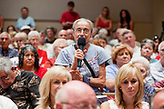 Aug, 25, 2009 -- SUN CITY, AZ: RIVKO KNOX, from Phoenix, questions Sen John McCain about previous Republican efforts to reform health care during the Town Hall meeting on health care sponsored by Sen McCain at Grace Bible Church in Sun City, AZ, Tuesday. More than 1,000 people attended the meeting in the church, which seats 700. Sun City is a staunchly Republican suburb of Phoenix and most of the crowd was opposed to President Obama health care reform efforts. Knox was one of only a handful of people at the meeting who support the president's health care reform efforts.  Photo by Jack Kurtz