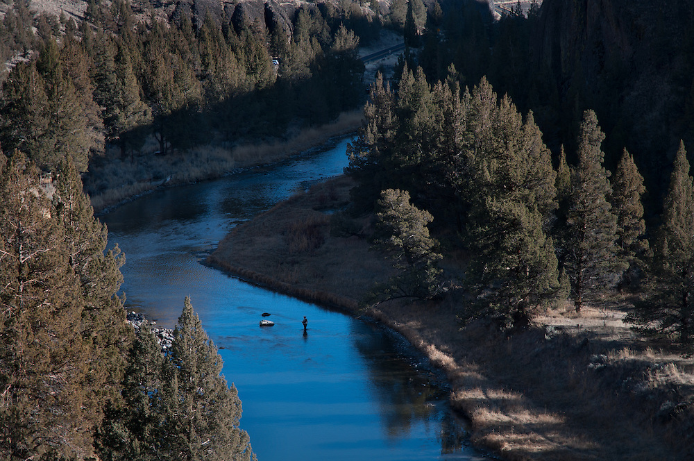 A fly fisherman makes a cast on the Crooked River.